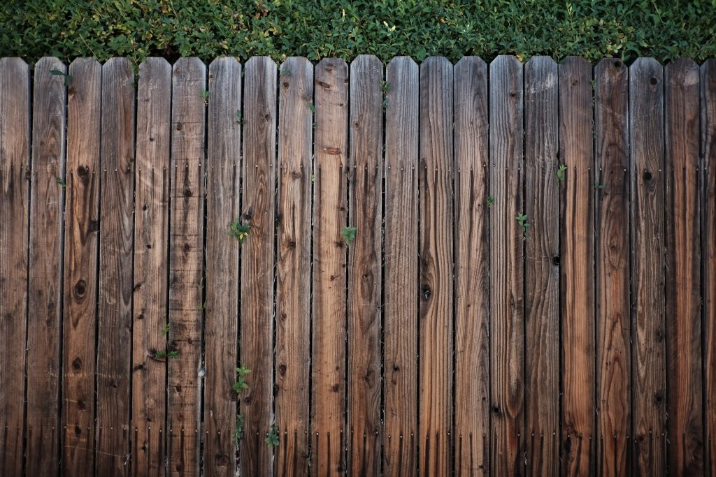 wooden fence without paint
